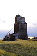 Country Scenes Prints - An Old Grain Elevator Off Highway Two In Montana Print by Jeff  Swan