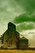 Farming Barns Photo Prints - An Old Grain Silo In Eastern Montana Print by Jeff  Swan