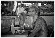 Light And Shadow Photos - An old man with tattoo in Thai market by Setsiri Silapasuwanchai