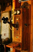 Phones Photos - An Old Telephone by Jeff  Swan