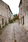 French Village Framed Prints - An Old Village Street Framed Print by Olivier Le Queinec
