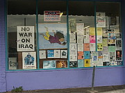 Iraq Posters Photo Framed Prints - Anti-Iraq War posters 4th avenue book store window Tucson Arizona 2000 Framed Print by David Lee Guss