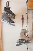 Antique Skates Photo Posters - Antique ice skates hanging on a wall. Poster by Don Landwehrle