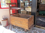 Store Fronts Prints - Antique Store Cart Print by Donna Wilson