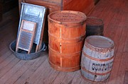 Rusted Barrels Framed Prints - Antique Western Still Life Framed Print by John Malone