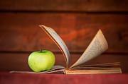 Apple And Book Print by Michal Bednarek