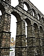 Grey Clouds Photos - Aqueduct of Segovia - Spain by Juergen Weiss