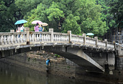 Wan-li Prints - Arched Chinese bridge with umbrellas - Shamian Island - Guangzhou - Canton - China Print by David Hill