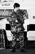 Violent Prints - Armed British soldier at PSNI landrover on crumlin road at ardoyne shops belfast 12th July Print by Joe Fox