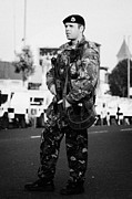 Violent Prints - Armed British soldier on crumlin road at ardoyne shops belfast 12th July Print by Joe Fox