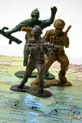 Iraq Conflict Prints - Armed Toy Soliders on Iraq Map Print by Amy Cicconi