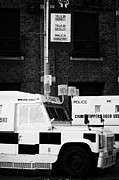 Unrest Framed Prints - Armoured PSNI land rovers under protest sign banner on crumlin road at ardoyne  Framed Print by Joe Fox