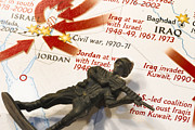 Iraq Conflict Prints - Army Man lying on Middle East Conflicts Map Print by Amy Cicconi