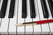 Keyboards Prints - Artist brush on piano keys Print by Garry Gay