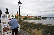 Vltava River Framed Prints - Artist on the Charles Bridge - Prague Framed Print by Madeline Ellis