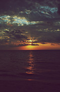 Caribbean Sea Photo Prints - As Day Turns into Night Print by Laurie Search