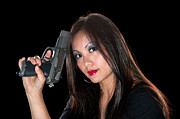 Female Spy Framed Prints - Asian woman with gun Framed Print by Joe Belanger