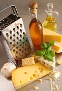 Buffet Posters - Assortment of cheeses and olive oil on table Poster by Sandra Cunningham