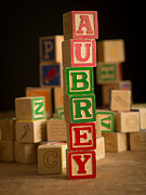 Wooden Blocks Framed Prints - AUBREY - Alphabet Blocks Framed Print by Edward Fielding