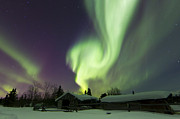 Log Cabin Prints - Aurora Borealis Over A Log Cabin Print by Joseph Bradley
