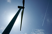 Renewable Photos - Backlighting of a wind turbine and plane. by Bernard Jaubert