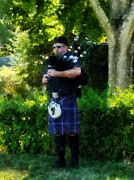 Bagpipers Framed Prints - Bagpiper Framed Print by Susan Savad