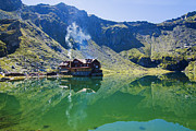Romania Photos - Balea Lake chalet reflection by Mircea Costina Photography