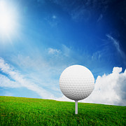 Golf Posters - Ball on tee on green golf field Poster by Michal Bednarek