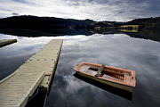 Rowboat Photos - Bark on a lake in Auvergne. France by Bernard Jaubert