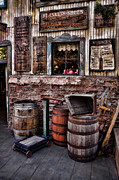 Wooden Structures Prints - Barrels and Signs Print by Ken Smith