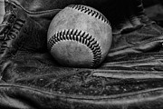 Glove Framed Prints - Baseball broken in black and white Framed Print by Paul Ward