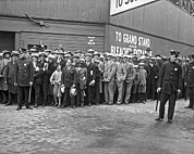 Baseball Stadiums Framed Prints - Baseball fans waiting in line to buy World Series tickets. Framed Print by Underwood Archives