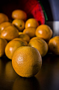Reflection Harvest Photo Posters - Basket of Oranges Poster by Jeff Burton