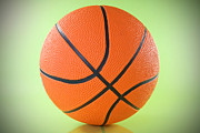 Basket Ball Game Posters - Basketball Ball Over A Green Background Poster by G J