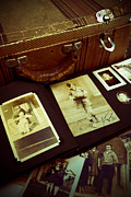 Suitcase Framed Prints - Battered Suitcase of Antique Photographs Framed Print by Amy Cicconi