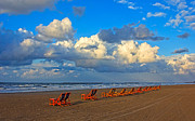 Idling Prints - Beach and chairs with cloudy sky Print by Mohamed Elkhamisy