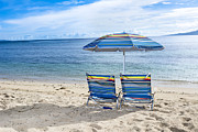 Joe Belanger - Beach chairs on tropical...