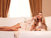 Drapery Photo Prints - Beautiful glamorous woman with long blond hair lying on sofa Print by Oleksiy Maksymenko