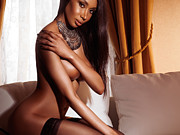 Three-quarter Length Framed Prints - Beautiful sexy half nude black woman posing on sofa Framed Print by Oleksiy Maksymenko