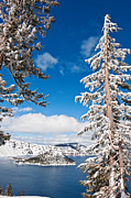 Jamie Pham - Beautiful view of Crater Lake covered in snow in the winter.