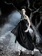 Haute Couture Posters - Beautiful woman in long dress in a mysterious forest Poster by Oleksiy Maksymenko