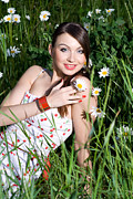 Youthful Prints - Beautiful Woman Sitting in tall grass and daisies Print by Diana Jo Marmont
