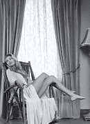 Drapery Photo Prints - Beautiful young woman in a rocking chair Black and white Print by Oleksiy Maksymenko