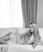 Drapery Photo Prints - Beautiful young woman with blond hair lying on white sofa Black  Print by Oleksiy Maksymenko