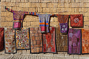 Carpet Photo Posters - Bed covers and clothes for sale inside Jailsalmer Fort in Rajasthan India Poster by Robert Preston