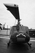 Manhaten Prints - Bell UH 1A uh1 1 Huey on display on the flight deck at the Intrepid Sea Air Space Museum Print by Joe Fox