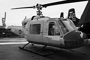 Manhatan Prints - Bell UH 1A uh1 uh1a 1 Huey on display on the flight deck at the Intrepid Sea Air Space Museum Print by Joe Fox