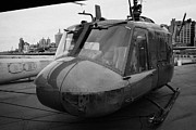 Manhatten Posters - Bell UH1 Huey on display on the flight deck of the USS Intrepid at the Intrepid Sea Air Space Museu Poster by Joe Fox