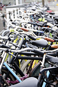 Bicycle Photos - Bicyles parked along the street by Oscar Gutierrez