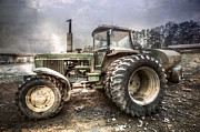 Antique Tractors Photos - Big John in Winter by Debra and Dave Vanderlaan